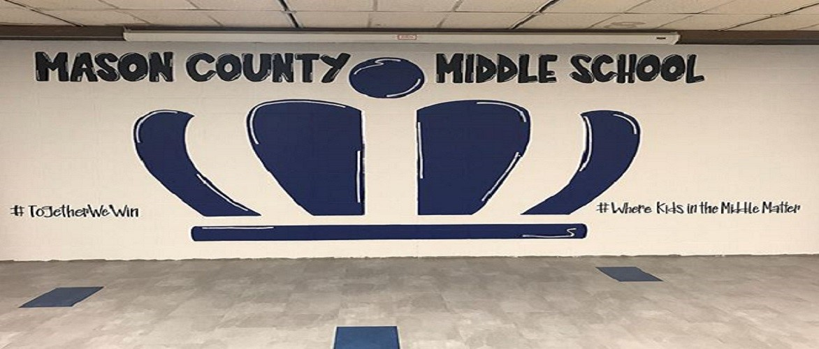 Picture of the crown painted on the wall in the commons area.  Crown is blue and wall is white